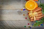 Orange with cinnamon — Stock Photo