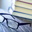 Glasses and books — Stock Photo #38060575