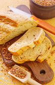 Bread on a wooden board — Stock Photo