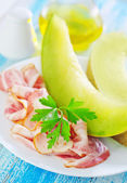 Melon with ham — Stock Photo