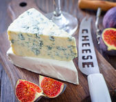 Cheese on a board — Stock Photo