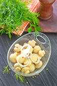 Tasty champignon in bowl — Stock Photo