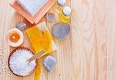 Sea salt, soap and towels — Stock Photo
