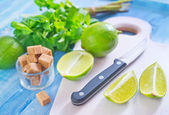 Fresh limes with mint — Stock Photo