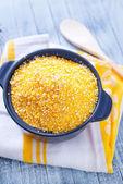 Corn porridge in a plate — Stock Photo