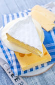 Brie cheese with a knife — Stock Photo