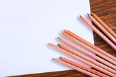 Paper and colored pencils — Stock Photo