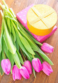 Gift box and tulips — Stock Photo