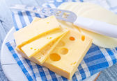 Cheese slices with a knife — Stock Photo