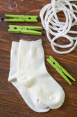 Socks, rope and clothespins — Stock Photo