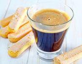 Coffee and savoyardi — Stock Photo