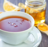 Tea with honey and lemon — Stock Photo