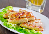 Sausages on plate — Stockfoto