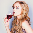 Beautiful blond woman with glass red wine — Stock Photo