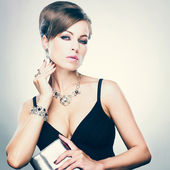 Beautiful woman with evening make-up. Jewelry and Beauty. Fashion photo — 图库照片