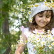 Smiling girl playing on the meadow — Stock Photo