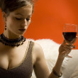 Beautiful woman with wine in bed — Stock Photo