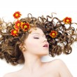 Beautiful woman with long curly hair — Stock Photo
