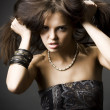 Beautiful young woman with dark hair - Stock Photo