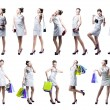 Young beautiful woman with shopping bags and handbag — Stock Photo