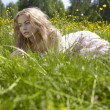 Beautiful girl on green field — Stock Photo