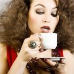 Beautiful woman drinking coffee — Stock Photo #18449947