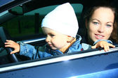 Mother and son in a car — Stock Photo