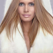 Beautiful woman with white fur — Stock Photo