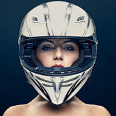 Sexy woman in helmet on dark background — Stok fotoğraf