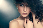 Fashion photo of sensual brunette woman with shiny curly hair — Stock Photo