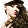 Beautiful young model in hat — Stock Photo