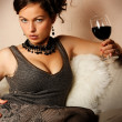 Beautiful woman with glass red wine - Stok fotoğraf