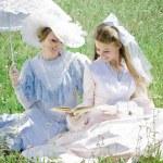 Two beautiful women in vintage dress — Stock Photo #18450629