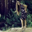 Beautiful girl in a wild forest — Stock Photo #18450897