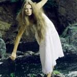 Beautiful girl on stones — Stock Photo