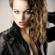 Sexy girl with leather jacket — Stock Photo