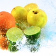 Splash water with freshnes fruits — Stock Photo