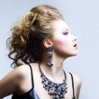 Elegant young blond girl. Profile view — Stock Photo