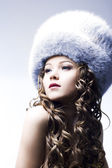 Beautiful lady in fur cap — Стоковое фото