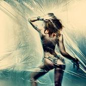 Portrait of dancing sexy woman with bikini — Stock Photo