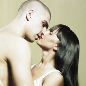 Photo of passionate couple. Man kissing woman — Stock Photo