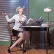 Stock Photo: Young woman at office. Retro photo style