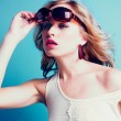 Beautiful blond woman with sunglasses — Stock Photo