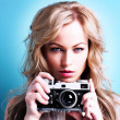 Blonde woman with camera — Stock Photo