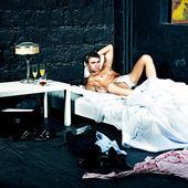 Sexual man in bedroom — Stock Photo
