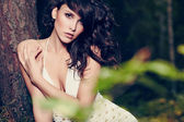 Beautiful girl in a wild forest — Stock fotografie
