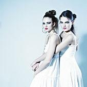 Fashion photo of two beautiful women — Stock Photo