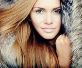 Pretty woman with fur — Stock Photo