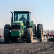 Agriculture tractor cultivating field — Stock Photo