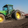 Agriculture tractor cultivating field — Stock Photo #26220073